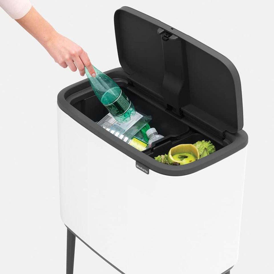"""<p>Why invest in a traditional option when you can have a stylish one that does your dirty work for you? This clean-lined steel and plastic bin sits on four angled legs and features two inner compartments, which makes quickly <a href=""""https://www.marthastewart.com/1538981/items-you-cant-recycle"""" rel=""""nofollow noopener"""" target=""""_blank"""" data-ylk=""""slk:separating recyclables seamless"""" class=""""link rapid-noclick-resp"""">separating recyclables seamless</a>.</p> <p><strong><em>Shop Now: </em></strong><em>Brabantia 316203 Bo Trash Can in Black, $129.99</em><em>, </em><a href=""""https://www.amazon.com/Brabantia-316203-Trash-Can-Black/dp/B073ZK51LH/ref=as_li_ss_tl?ie=UTF8&linkCode=ll1&tag=mslhomesleektrashcanscbiggssep20-20&linkId=a76a94894ce94301f864f34557ac96b4"""" rel=""""nofollow noopener"""" target=""""_blank"""" data-ylk=""""slk:amazon.com"""" class=""""link rapid-noclick-resp""""><em>amazon.com</em></a><em>.</em></p>"""