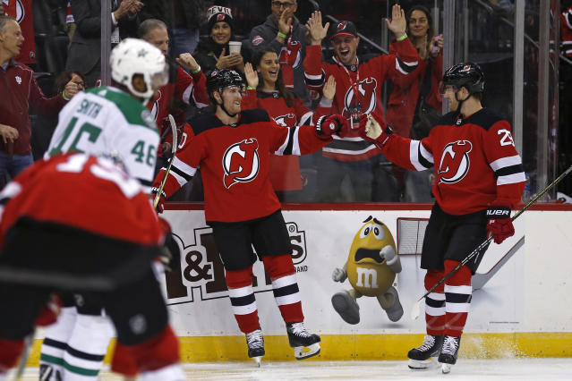 New Jersey Devils' Blake Coleman, center, celebrates scoring a goal with Devils' Damon Severson (28) against the Dallas Stars in the second period of an NHL hockey game Tuesday, Oct. 16, 2018, in Newark, NJ. (AP Photo/Adam Hunger)