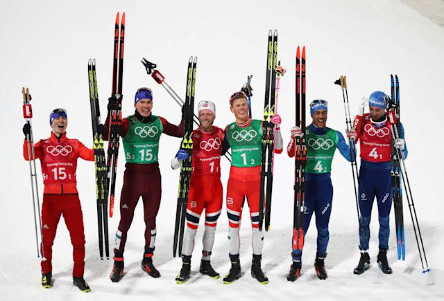Cross-Country Skiing - Pyeongchang 2018 Winter Olympics - Men's Team Sprint Free Finals - Alpensia Cross-Country Skiing Centre - Pyeongchang, South Korea - February 21, 2018. Johannes Hoesflot Klaebo and Martin Johnsrud Sundby of Norway celebrate winning gold with athletes from Russia and France . REUTERS/Carlos Barria