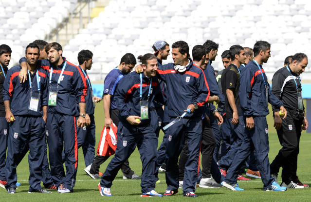 Iran's players visit Mineirao stadium in Belo Horizonte, Brazil, Friday, June 20, 2014. Iran plays in group F at the soccer World Cup. (AP Photo/Eugenio Savio)