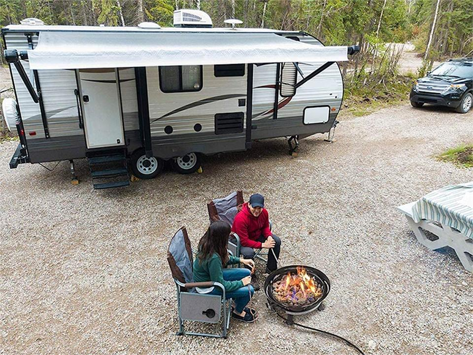 Outland Firebowl 893 Deluxe Outdoor Portable Propane Gas Fire Pit is a safe choice for camping trips and backyard use. Image via Amazon.