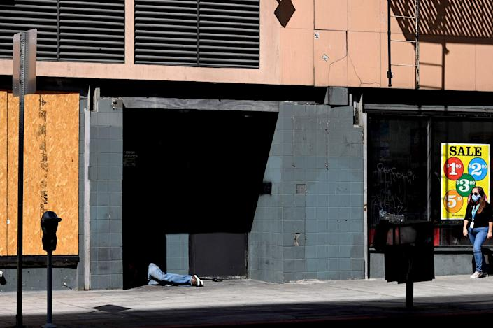 Image: A person lays in a doorway in downtown Los Angeles on Oct. 2, 2020. (Robyn Beck / AFP - Getty Images file)