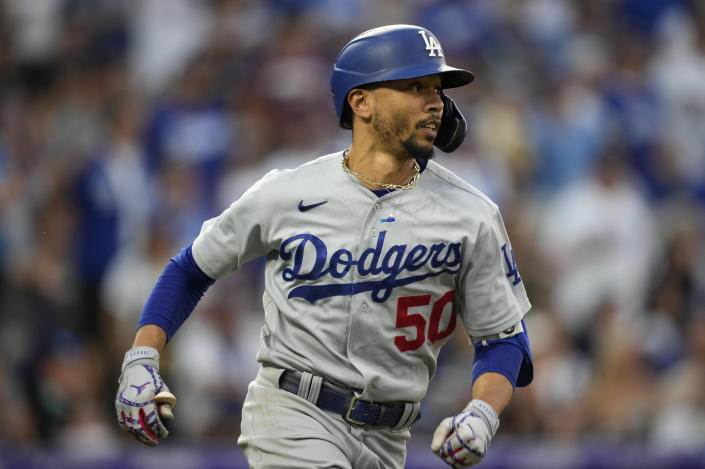 Los Angeles Dodgers' Mookie Betts watches his double off Colorado Rockies relief pitcher Mychal Givens during the seventh inning of a baseball game Saturday, July 17, 2021, in Denver. (AP Photo/David Zalubowski)