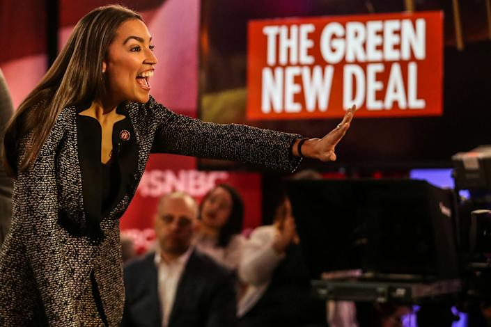 "U.S. Representative Alexandria Ocasio-Cortez (D-NY) greets audiences following a televised town hall event on the ""Green New Deal"" in the Bronx borough of New York City, New York, U.S., March 29, 2019. REUTERS/Jeenah Moon   TPX IMAGES OF THE DAY"