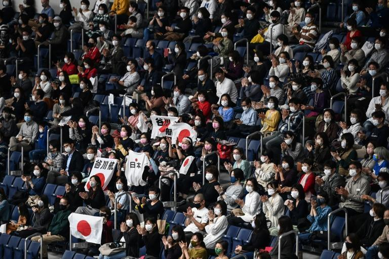 Fans in face masks attended an international gymnastics competition in Tokyo on Sunday