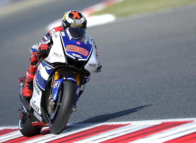 Yamaha Factory Racing's Spanish rider Jorge Lorenzo rides past at the Catalunya racetrack in Montmelo, near Barcelona, on June 2, 2012, during the MotoGP third training session of the Catalunya Moto GP Grand Prix. AFP PHOTO/LLUIS GENELLUIS GENE/AFP/GettyImages