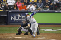 Los Angeles Dodgers' Justin Turner (10) hits a two-run home run during the eighth inning of Game 2 of the National League Championship Series baseball game against the Milwaukee Brewers Saturday, Oct. 13, 2018, in Milwaukee. (AP Photo/Charlie Riedel)