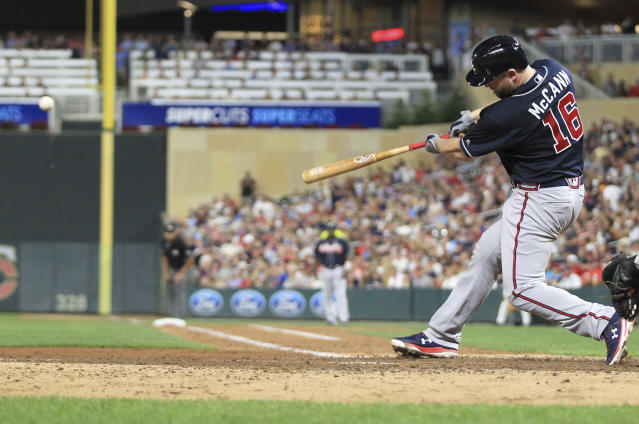 Atlanta Braves' Brian McCann hits a two-run single against the Minnesota Twins during the sixth inning of a baseball game Tuesday, Aug. 6, 2019, in Minneapolis. (AP Photo/Andy Clayton- King)