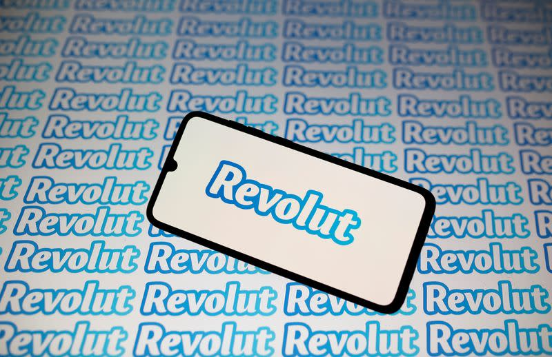 Smartphone with Revolut logo is seen in this illustration