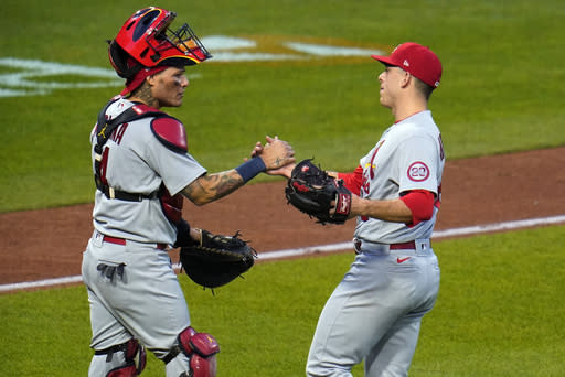 St. Louis Cardinals relief pitcher Ryan Helsley, right, celebrates with catcher Yadier Molina after the first baseball game of the team's doubleheader against the Pittsburgh Pirates in Pittsburgh, Friday, Sept. 18, 2020. The Cardinals won 6-5. (AP Photo/Gene J. Puskar)