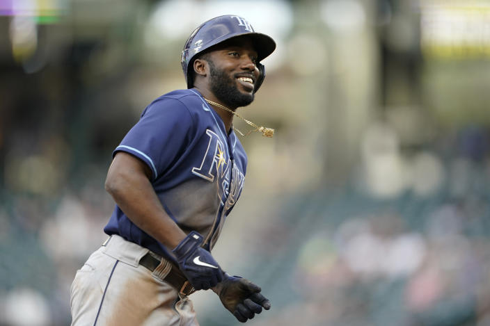 Tampa Bay Rays' Randy Arozarena smiles as he runs the bases after hitting a two-run home run during the fourth inning of the team's baseball game against the Seattle Mariners on Thursday, June 17, 2021, in Seattle. (AP Photo/Ted S. Warren)