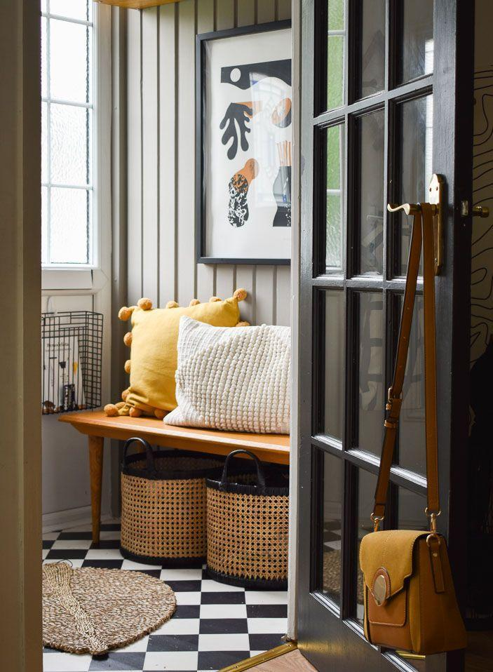 """<p>""""This is a super tiny space just before you enter into my living room. It houses all the coats, shoes, hats, etc. The <a href=""""https://go.redirectingat.com?id=127X1599956&url=https%3A%2F%2Fwww2.hm.com%2Fen_gb%2Fproductpage.0863169001.html&sref=https%3A%2F%2Fwww.harpersbazaar.com%2Fuk%2Fculture%2Flifestyle_homes%2Fg35595137%2Finside-the-home-of-interiors-blogger-medina-grillo%2F"""" rel=""""nofollow noopener"""" target=""""_blank"""" data-ylk=""""slk:H&M basket"""" class=""""link rapid-noclick-resp"""">H&M basket</a> under the bench is for all our shoes, and the shelf above is for hats and scarves. The basket on the wall is held in place by a command hook, and usually catches any letter posted through the door.""""</p>"""