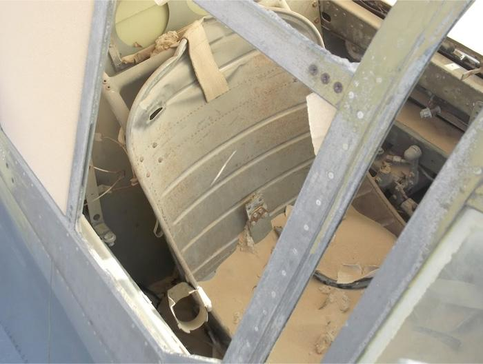 The seat is in the same condition as the day the pilot stepped over the side with his parachute and exited the wrecked P-40. The light accumulation of sand seems to indicate that the canopy was closed for all these years with minimum sand intrusion. (Jakub Perka/BNPS)