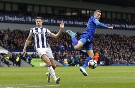 Britain Football Soccer - West Bromwich Albion v Leicester City - Premier League - The Hawthorns - 29/4/17 Leicester City's Jamie Vardy in action with West Bromwich Albion's Jonny Evans Reuters / Darren Staples Livepic