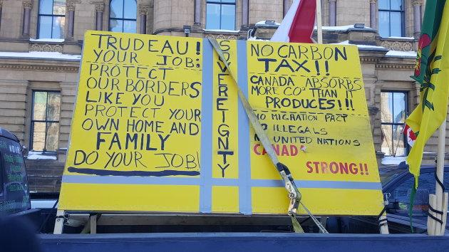 "A sign is affixed onto a truck at the ""United We Roll"" convoy."