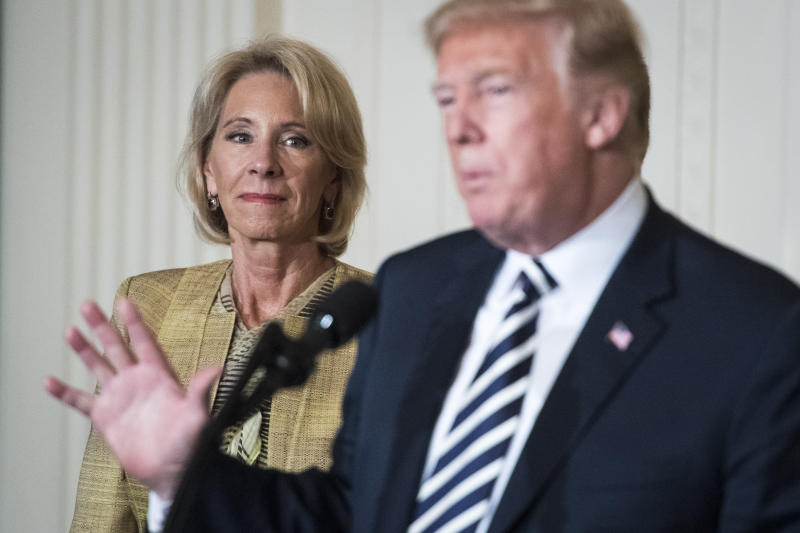 WASHINGTON, DC - MAY 2: Secretary of Education Betsy DeVos listens as President Donald J. Trump gives remarks at the National Teacher of the Year reception in the East Room of the White House on Wednesday, May 02, 2018 in Washington, DC. (Photo by Jabin Botsford/The Washington Post via Getty Images)