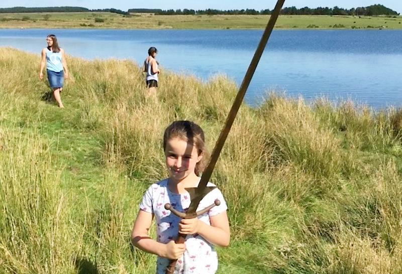 The 7-year-old was swimming around the lake last week when she spotted the sword on the ground. (SWNS)