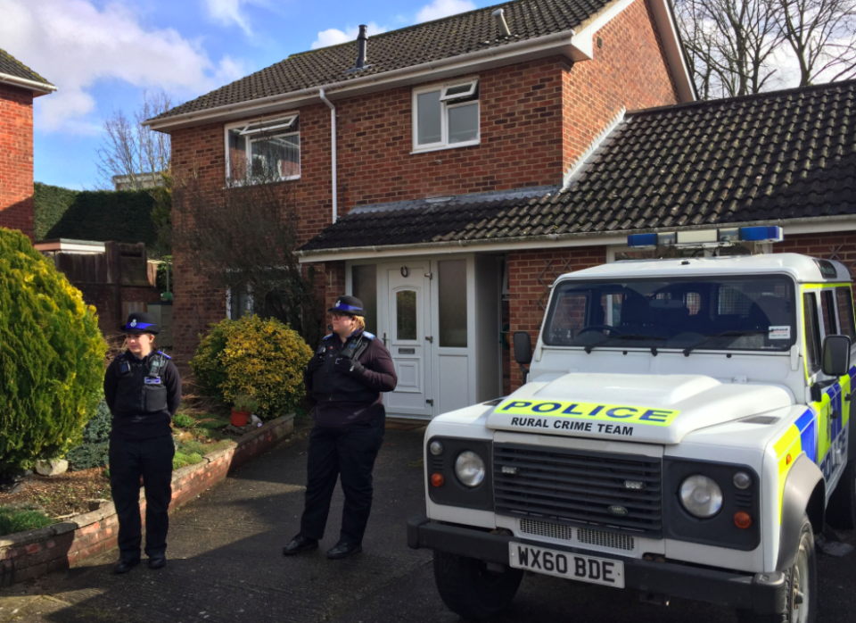 <em>Officers standing outside the home of Sergei Skripal following the attack earlier this year (PA)</em>