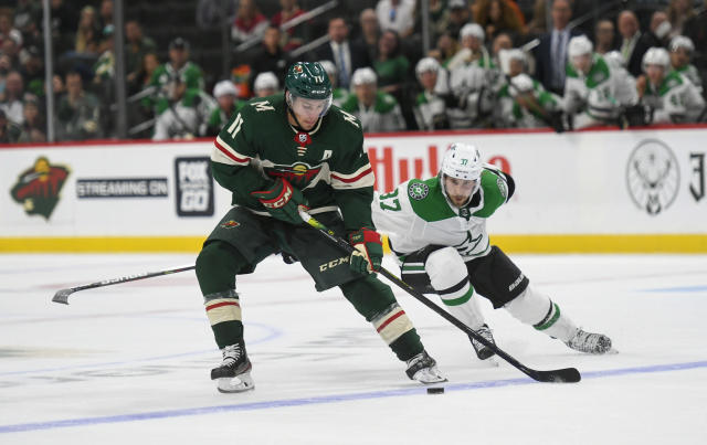 Minnesota Wild winger Zach Parise, left, skates past Dallas Stars center Justin Dowlingduring the third period of a preseason NHL hockey game Tuesday, Sept. 17, 2019, in St. Paul, Minn. (AP Photo/Craig Lassig)