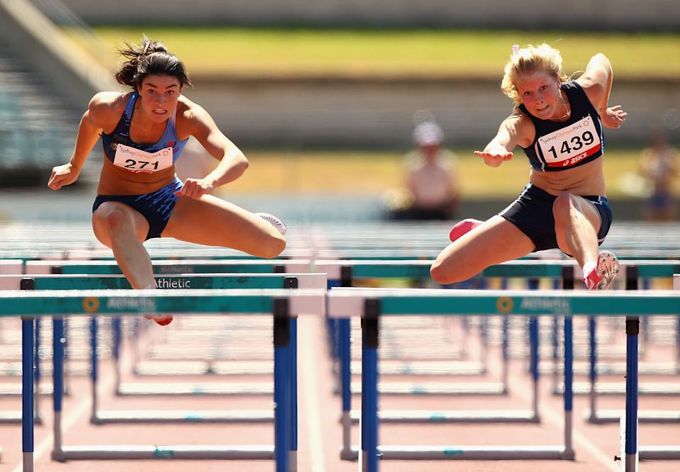 SYDNEY, AUSTRALIA - MARCH 12: Michelle Jenneke (L) and Brooke Stratton (R) compete in the Womens Under 20 100m Hurdles Final during day three of the Australian Junior Athletics Championships at Sydney Olympic Park Athletic Centre on March 12, 2011 in Sydney, Australia. (Photo by Ryan Pierse/Getty Images)