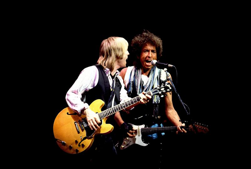 Tom Petty (left) and Bob Dylan perform onstage at the Poplar Creek Music Theater in Hoffman Estates, Chicago, Illinois, July 22nd, 1986