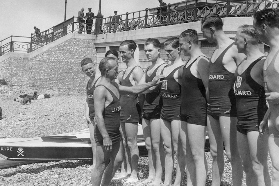"""<p>Lifeguards at Brighton Beach in 1935 were assessed in morning meetings before heading to their posts.</p><p><strong>RELATED:</strong> <a href=""""https://www.goodhousekeeping.com/life/g4144/summer-quotes/"""" rel=""""nofollow noopener"""" target=""""_blank"""" data-ylk=""""slk:20 Summer Quotes That'll Make You Feel Like You're on Vacation"""" class=""""link rapid-noclick-resp"""">20 Summer Quotes That'll Make You Feel Like You're on Vacation</a></p>"""