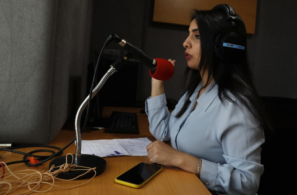 Palestinian journalist Rewaa Mershid works at the studio of ZMN FM radio station in Gaza City, Thursday, May 6, 2021. Mershid, a 26-year-old reporter for a local radio station, was with colleagues filming at a privately owned farm near the heavily guarded Gaza frontier on April 25 when two members of a Hamas-run border patrol approached and asked them to identify themselves. (AP Photo/Adel Hana)