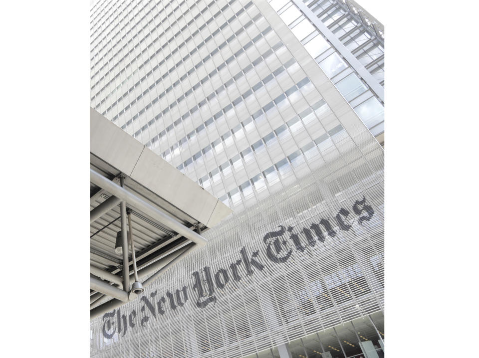 """FILE - This June 22, 2019 file photo shows the exterior of the New York Times building in New York. The New York Times says it was wrong to trust the story of a Canadian man whose claims of witnessing and participating in atrocities as a member of the Islamic State was a central part of its award-winning 2018 podcast """"Caliphate."""" The 12-part series won a Peabody Award and was a Pulitzer Prize finalist. But it began to unravel when Canadian authorities in September arrested Shehroze Chaudhry on charges of perpetrating a terrorist hoax. He was included in the podcast under the alias Abu Huzayfah. The Times said its journalists should have done a better job vetting him, and not included his story as part of the podcast. (AP Photo/Julio Cortez, File)"""