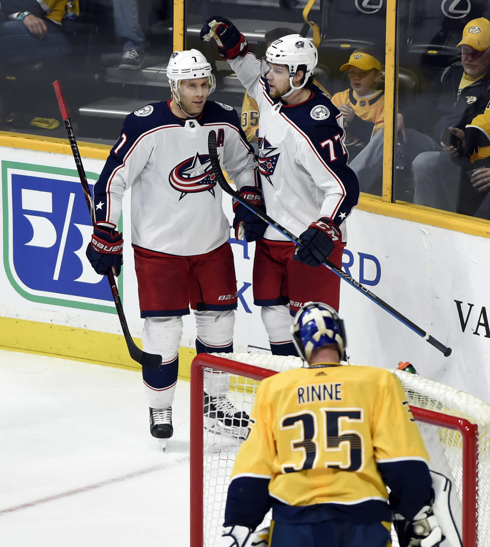Columbus Blue Jackets right wing Josh Anderson (77) celebrates with defenseman Jack Johnson (7) after scoring a goal against Nashville Predators goaltender Pekka Rinne (35), of Finland, during the second period of an NHL hockey game Saturday, April 7, 2018, in Nashville, Tenn. (AP Photo/Mark Zaleski)
