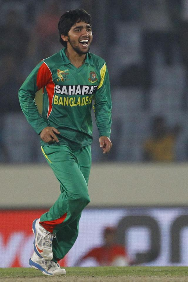 Bangladesh's Mominul Haque, celebrates the wicket of Pakistan's Sohaib Maqsood during their match in the Asia Cup one-day international cricket tournament in Dhaka, Bangladesh, Tuesday, March 4, 2014. (AP Photo/A.M. Ahad)
