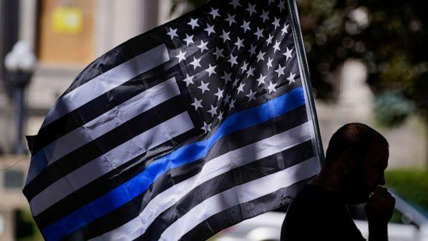 PHOTO: An unidentified man participates in a Blue Lives Matter rally Sunday, Aug. 30, 2020, in Kenosha, Wis. (Morry Gash/AP)
