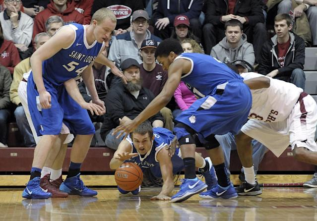 Saint Louis' Mike Crawford dives doe a loose ball during the first half of an NCAA college basketball game against Saint Joseph's on Wednesday, Feb. 5, 2014, in Philadelphia. (AP Photo/Michael Perez)