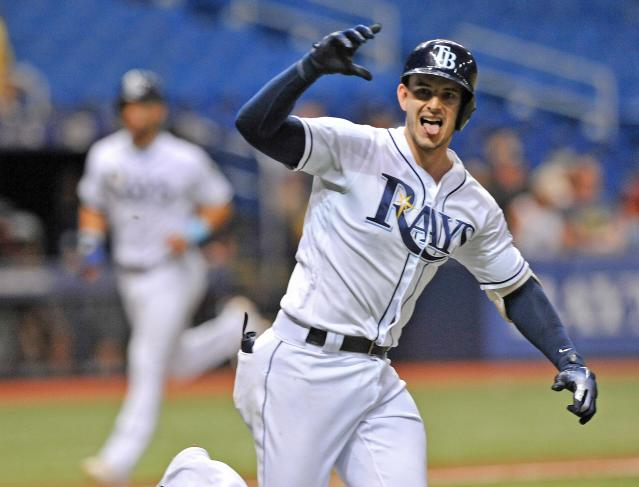 Tampa Bay Rays' Daniel Robertson gestures toward the dugout after hitting a walk-off RBI-single off Detroit Tigers reliever Blaine Hardy to score Kevin Kiermaier, left, during the 10th inning of a baseball game Monday, July 9, 2018, in St. Petersburg, Fla. (AP Photo/Steve Nesius)