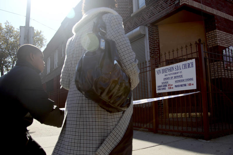 Pedestrians walk past New Dimension Church in New York, Sunday, Oct. 21, 2012. Vindalee Smith, 38, who was eight months pregnant and was found stabbed to death Saturday in her apartment, was to supposedbe married in this church today, police said. (AP Photo/Seth Wenig)