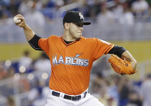 Miami Marlins' Jose Fernandez delivers a pitch during the first inning of a baseball game against the Los Angeles Dodgers, Sunday, May 4, 2014, in Miami. (AP Photo/Wilfredo Lee)