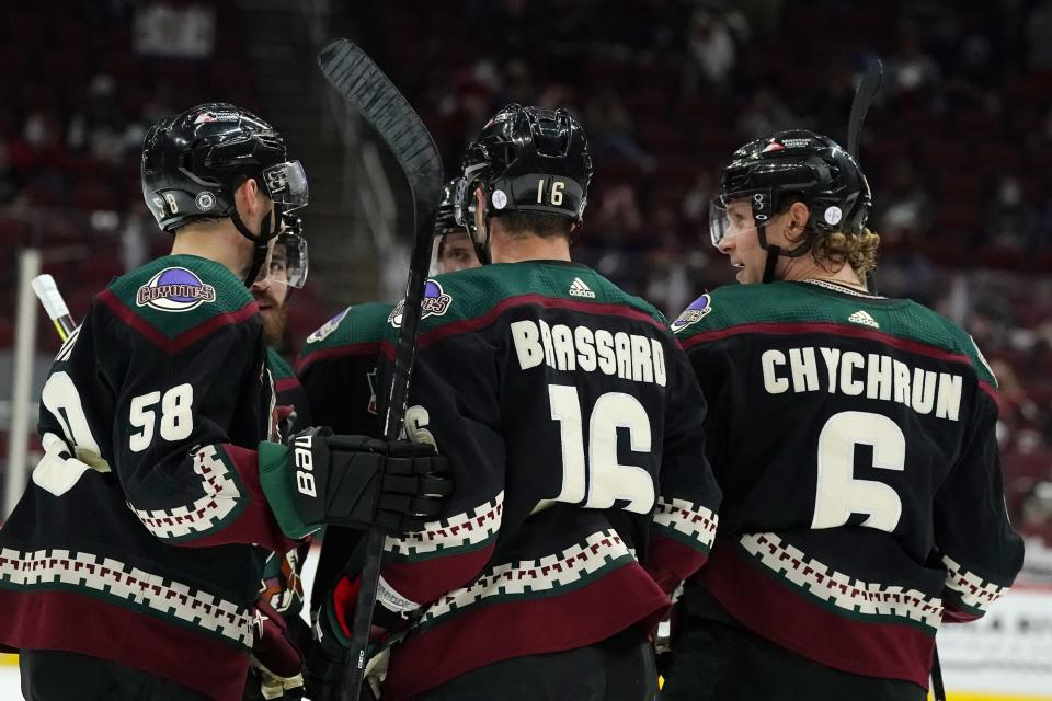 Arizona Coyotes defenseman Jakob Chychrun (6) celebrates his goal against the Los Angeles Kings with teammates, including left wing Michael Bunting (58) and center Derick Brassard (16), during the first period of an NHL hockey game Wednesday, May 5, 2021, in Glendale, Ariz. (AP Photo/Ross D. Franklin)