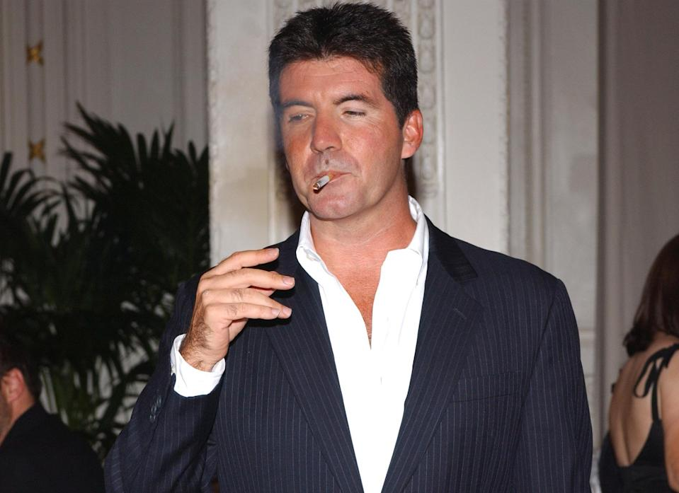 Pop svengali Simon Cowell's during the launch of his new band new band Il Divo, at the Mandarin Oriental in London. Cowell's Syco Music launched the new international operatic vocal group last night during a champagne reception for the media.