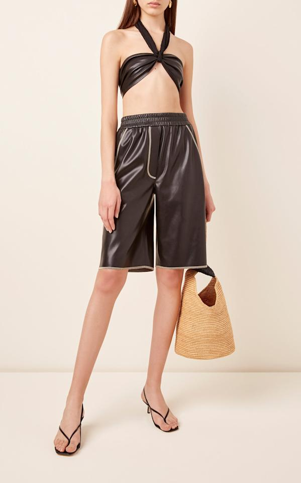 """<p>Pair these <a href=""""https://www.popsugar.com/buy/Nanushka-Yolie-Faux-Leather-Shorts-552501?p_name=Nanushka%20Yolie%20Faux%20Leather%20Shorts&retailer=modaoperandi.com&pid=552501&price=395&evar1=fab%3Aus&evar9=47263898&evar98=https%3A%2F%2Fwww.popsugar.com%2Fphoto-gallery%2F47263898%2Fimage%2F47264257%2FNanushka-Yolie-Faux-Leather-Shorts&list1=shopping%2Cshorts%2Cleather%2Cspring%20fashion&prop13=api&pdata=1"""" rel=""""nofollow"""" data-shoppable-link=""""1"""" target=""""_blank"""" class=""""ga-track"""" data-ga-category=""""Related"""" data-ga-label=""""https://www.modaoperandi.com/nanushka-ss20/yolie-faux-leather-shorts"""" data-ga-action=""""In-Line Links"""">Nanushka Yolie Faux Leather Shorts</a> ($395) with a cute crop top and strappy sandals for Summer or boots and a sweater for Spring.</p>"""