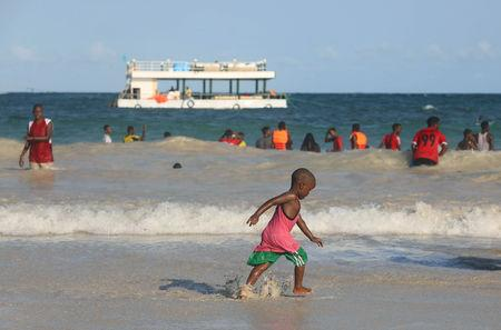 Young boy walks along the seashore on the Lido beach in Mogadishu, Somalia May 1, 2019. Picture taken May 1, 2019. REUTERS/Feisal Omar