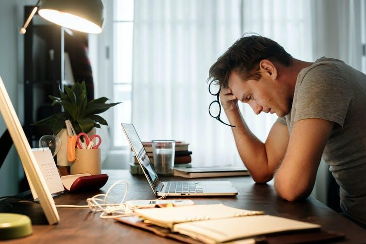 A man stressed at a desk