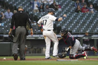 Seattle Mariners' Mitch Haniger is safe at home on a sacrifice fly by Jose Marmolejos as Cleveland Indians catcher Rene Rivera is unable to make the tag during the fifth inning of a baseball game Saturday, May 15, 2021, in Seattle. (AP Photo/Jason Redmond)