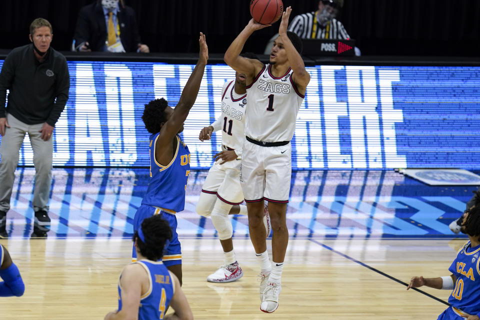 Gonzaga guard Jalen Suggs (1) shoots over UCLA guard David Singleton (34) to win the game during overtime in a men's Final Four NCAA college basketball tournament semifinal game, Saturday, April 3, 2021, at Lucas Oil Stadium in Indianapolis. Gonzaga won 93-90. (AP Photo/Michael Conroy)