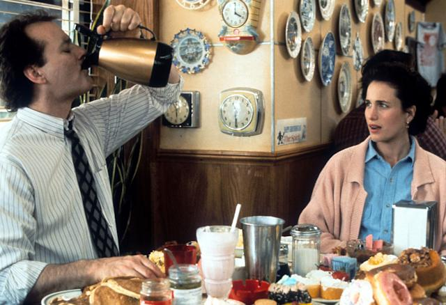 "Bill Murray puts down a pitcher of coffee with Andie MacDowell in a scene from the 1993 film ""Groundhog Day."""