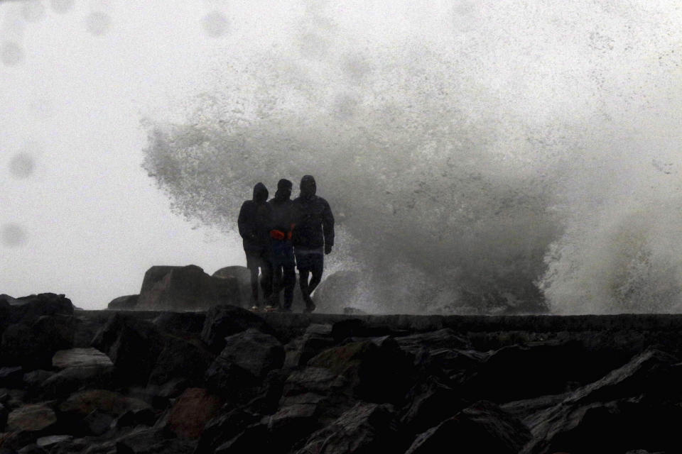 Waves hit the shore during a high tide at the Kasimedu Harbor on the Bay of Bengal coast in Chennai, India, Wednesday, Nov.25, 2020.