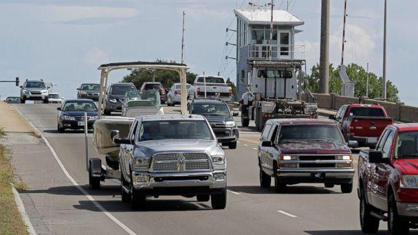 PHOTO: People drive over a drawbridge in Wrightsville Beach, N.C., as they evacuate the area in advance of Hurricane Florence, Tuesday, Sept. 11, 2018. (AP)