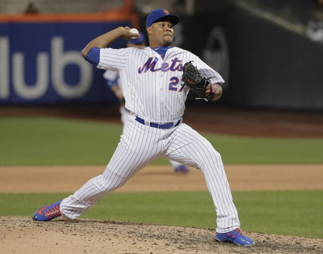 FILE - In this May 18, 2018, file photo, New York Mets pitcher Jeurys Familia (27) delivers against the Arizona Diamondbacks during the ninth inning of a baseball game in New York. The revamped Mets bullpen is set to include a very familiar face longtime reliever Jeurys Familia. Familia reached a free-agent deal with the team that traded him away last summer, a person with knowledge of the contract told The Associated Press late Wednesday night, Dec. 12, 2018. The person spoke on condition of anonymity at the winter meetings because the team had not yet announced the move. Familia likely must pass a physical for the contract to be finalized. (AP Photo/Julie Jacobson, File)
