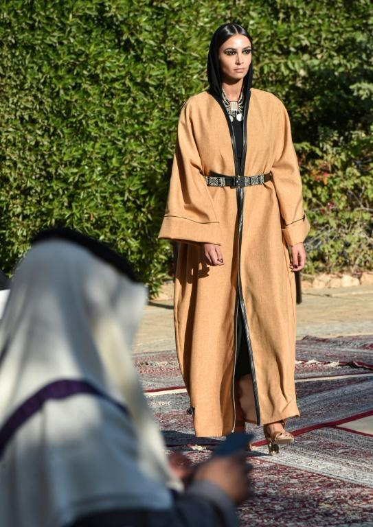 The private event in Riyadh showcased a new collection of abayas, a billowy, figure-concealing robe, to a small but mixed-gender audience