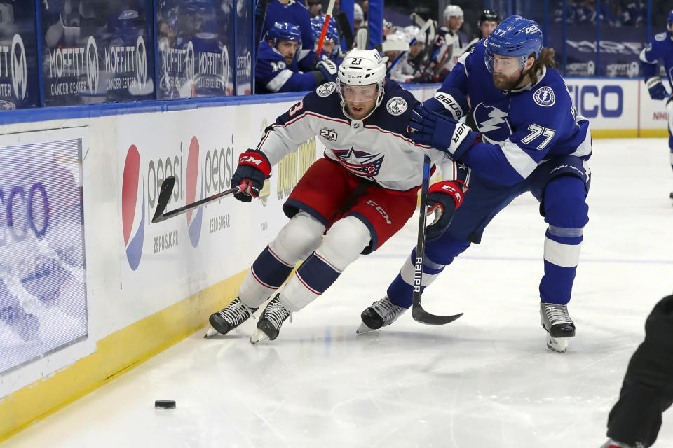 Tampa Bay Lightning defenseman Victor Hedman (77), of Sweden, defends against Columbus Blue Jackets' Stefan Matteau during the first period of an NHL hockey game Thursday, April 22, 2021, in Tampa, Fla. (AP Photo/Mike Carlson)