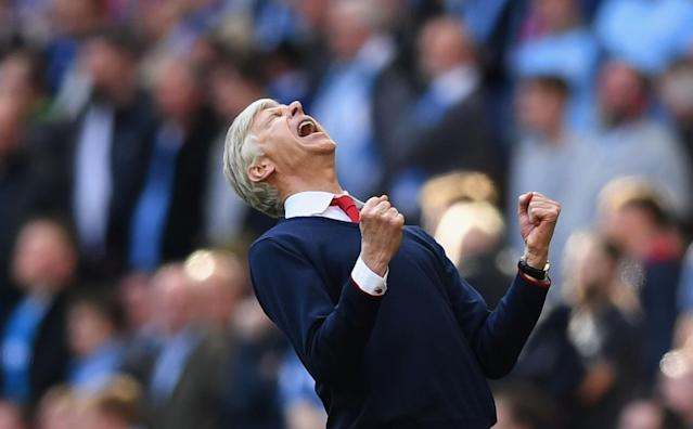 <p>Arsene Wenger celebrates as Alexis Sanchez edges the Gunners ahead against Manchester City in extra time </p>