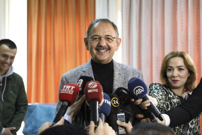 Mehmet Ozhaseki, the mayoral candidate for Ankara of Turkey's ruling Justice and Development Party, AKP and Nationalist Movement Party, MHP, talks to the media as his casts his ballot, in Ankara, Turkey, Sunday, March 31, 2019. Turkish citizens have begun casting votes in municipal elections for mayors, local assembly representatives and neighborhood or village administrators that are seen as a barometer of Erdogan's popularity amid a sharp economic downturn. (AP Photo/Ali Unal)